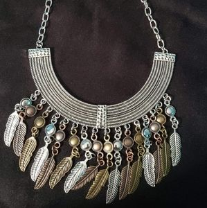 Multi metal feathers necklace with matching earrin